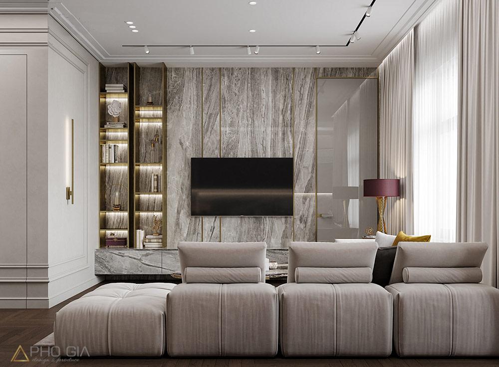 Thiết kế nội thất quận 7 Vách ốp tivi không thể tuyệt vời hơn với những nét vân đá tự do kết hợp chiếc kệ trang trí như vẽ nên một bức tranh cho mảng tường