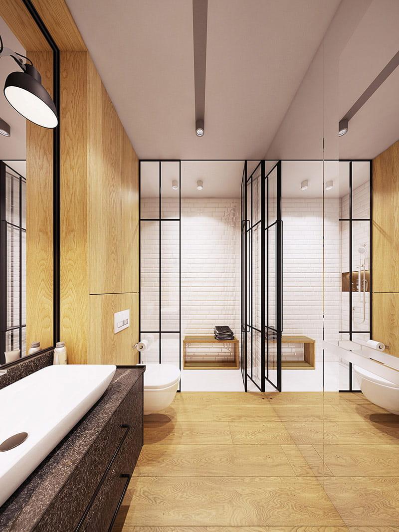 Ván sàn gỗ tương phản với tường phòng tắm.