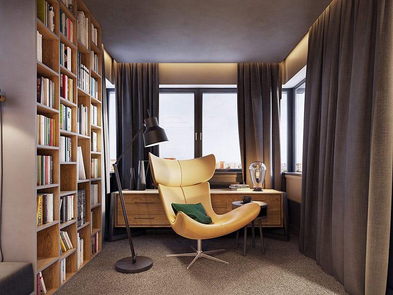 Ghế đọc sách đặt cạnh cửa sổ, để tận dụng ánh sáng tự nhiên.