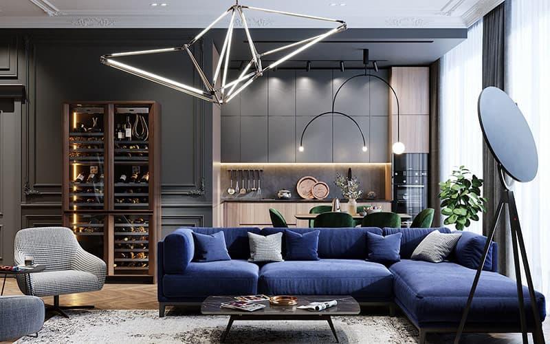 Màu xanh coban sinh động nổi bật xuyên qua trung tâm của một không gian thiết kế mở với điểm nhấn của ghế sofa hiện đại. Màu sắc mạnh mẽ làm đảo lộn một phông nền than ảm đạm, và lớp gỗ mềm mại xung quanh nó.