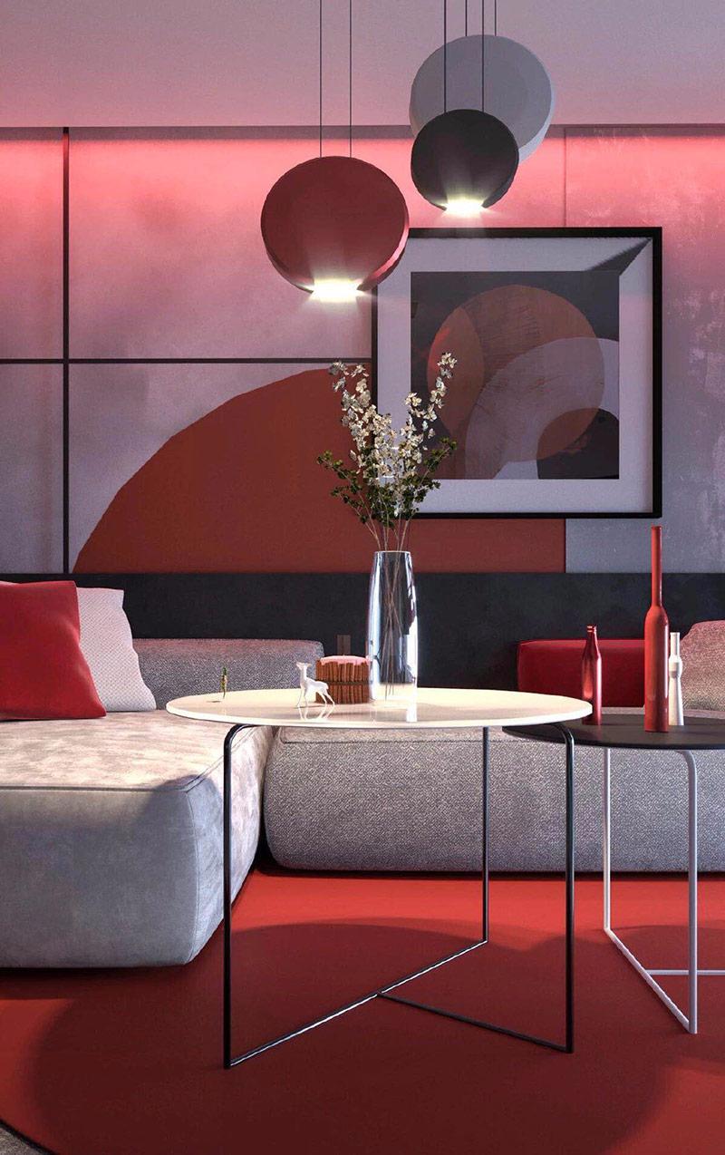 Các đĩa hình vòng cung trên bức tường đằng sau một chiếc ghế sofa hiện đại, nổi bật với tác phẩm nghệ thuật, đèn treo và như một tấm thảm bên dưới bàn cà phê lồng nhau có hình dạng tương tự. Toàn bộ căn phòng mang phong cách màu sắc đặc trưng của xứ sở mặt trời mọc.