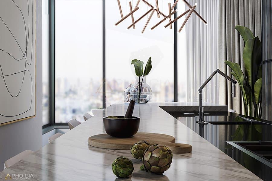 Ánh sáng tự nhiên mang lại cảm giác ấm cúng cho không gian bếp trong thiết kế nội thất biệt thự.