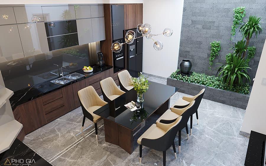 Không gian bếp kết hợp với giếng trời là một ý tưởng hoàn hảo cho thiết kế nội thất nhà phố.