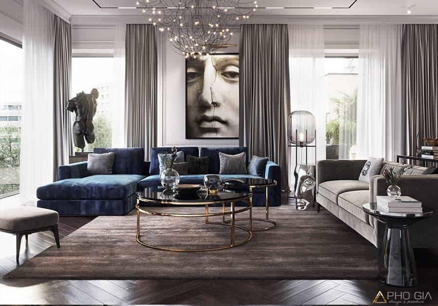 Thiết kế phòng khách với sự kết hợp giữa kim loại mạ vàng, nội thất màu trung tính và tranh nghệ thuật vô cùng ấn tượng.